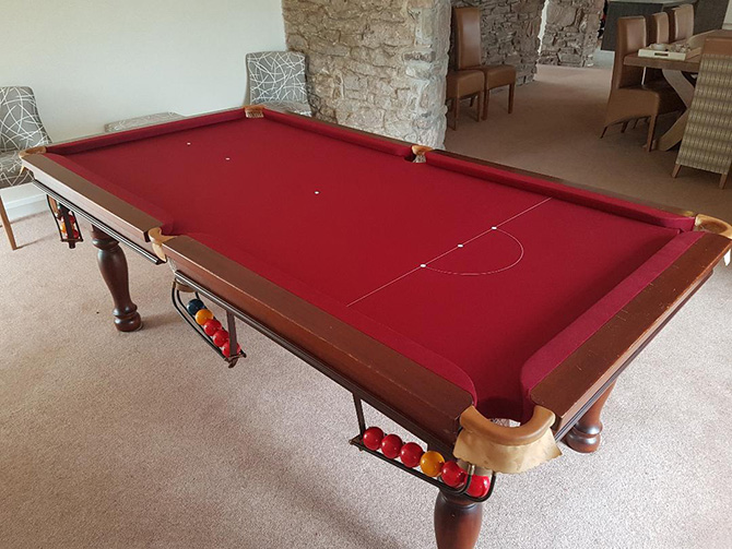 Recovered 7x4 snooker table in burgundy cloth