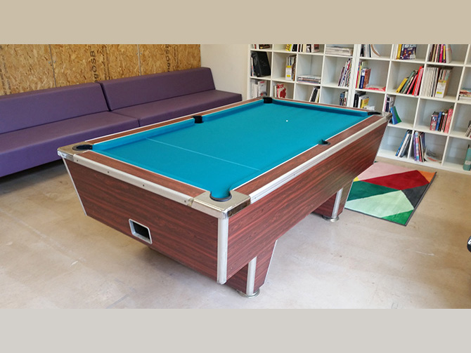 Turquoise pool table cloth fitting service