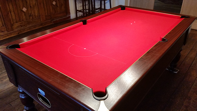 Bright red pool table recovering Caldicot Monmouthshire
